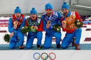 Олимпийские чемпионы в эстафетной гонке в биатлоне - Алексей Волков, Евгений Устюгов, Дмитрий Малышко и Антон Шипулин.
